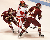 Erin Connolly (BC - 15), Nina Rodgers (BU - 23), Megan Keller (BC - 4) - The Boston College Eagles defeated the Boston University Terriers 3-2 in the first round of the Beanpot on Monday, January 31, 2017, at Matthews Arena in Boston, Massachusetts.