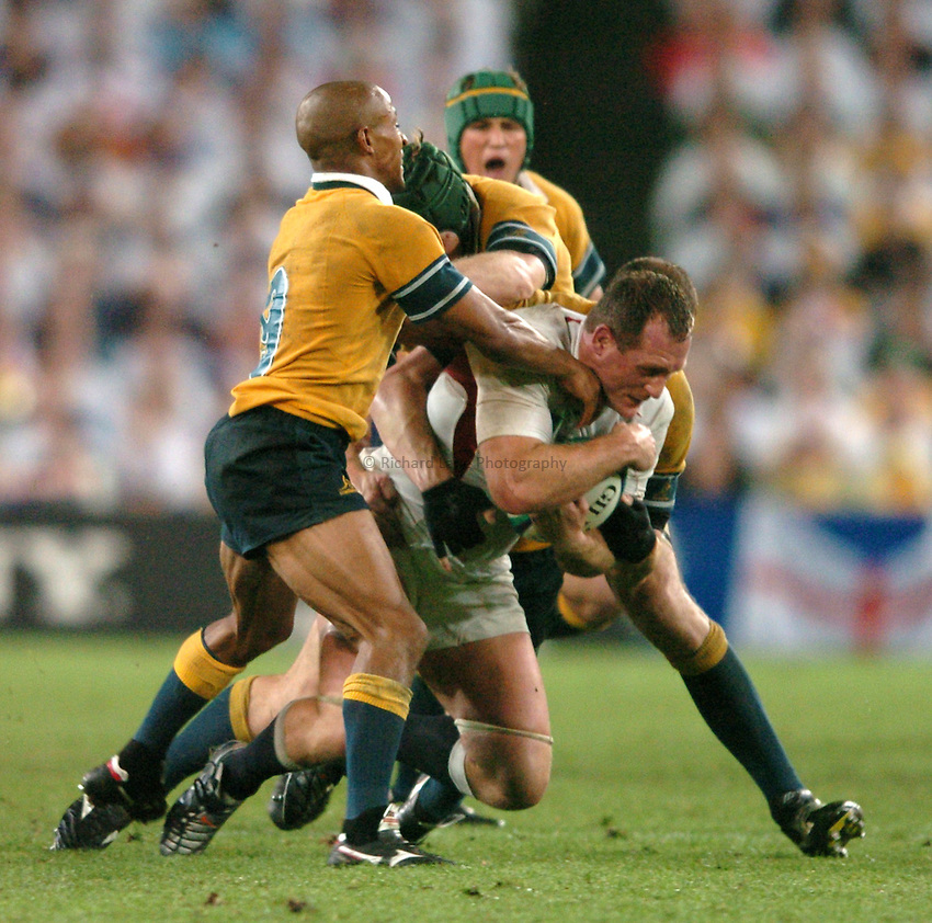 Photo: Richard Lane..Australia v England. Rugby World Cup Final, at the Telstra Stadium, Sydney. RWC 2003. 22/11/2003. .Richard Hill is wrapped up by the Australian defence.