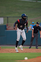 Richmond Flying Squirrels Jacob Heyward (13) leads off first base during an Eastern League game against the Bowie Baysox on August 15, 2019 at Prince George's Stadium in Bowie, Maryland.  Bowie defeated Richmond 4-3.  (Mike Janes/Four Seam Images)