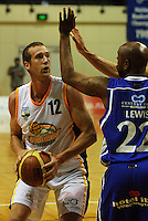 Tony Rampton looks to get past Terence Lewis during the NBL Basketball match between Wellington Saints and Devon Dynamos Taranaki at TSB Bank Arena, Wellington, New Zealand on Friday, 11 April 2008. Photo: Dave Lintott / lintottphoto.co.nz