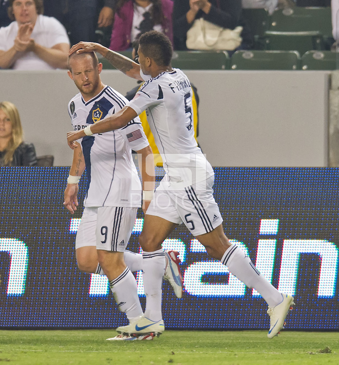 CARSON, CA - July 4, 2012: LA Galaxy players Chad Barrett (9) and Sean Franklin (5) celebrate a goal during the LA Galaxy vs Philadelphia Union match at the Home Depot Center in Carson, California. Final score LA Galaxy 1, Philadelphia Union 2.
