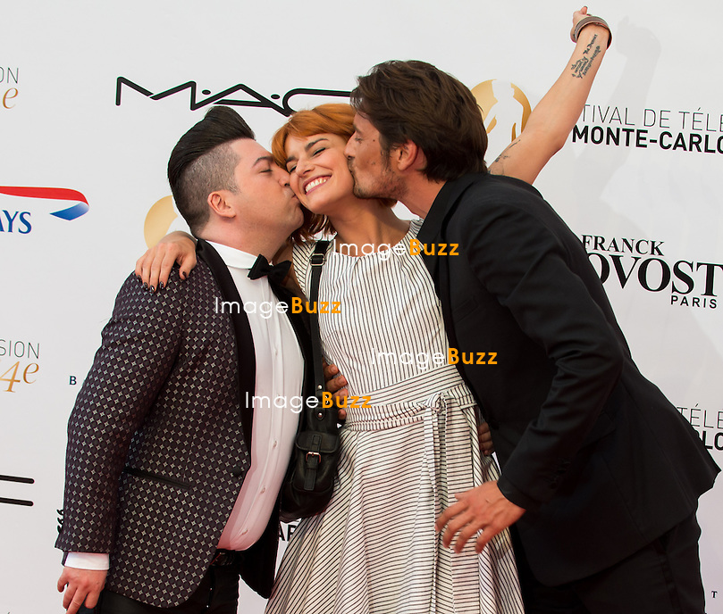 French dancer and choreographer Chris Marques (L) and French radio host Vincent Cerutti (R) give a kiss to French dancer Fauve Hautot (C) during the opening Ceremony of the 54st Monte-Carlo Television Festival