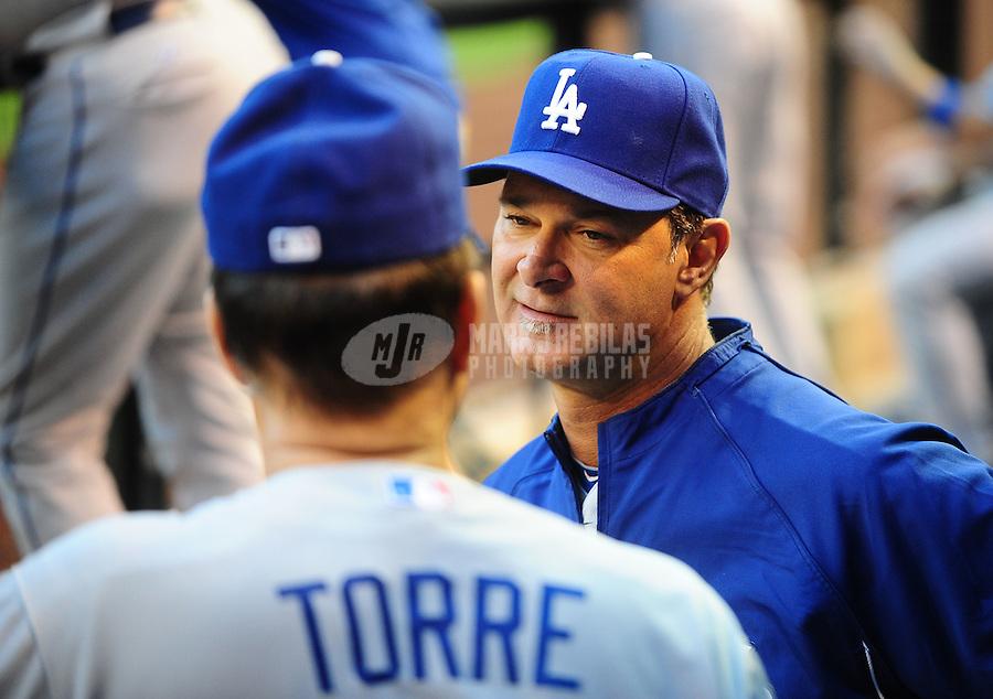 May 11, 2010; Phoenix, AZ, USA; Los Angeles Dodgers coach Don Mattingly (right) talks with manager Joe Torre against the Arizona Diamondbacks at Chase Field. Mandatory Credit: Mark J. Rebilas-