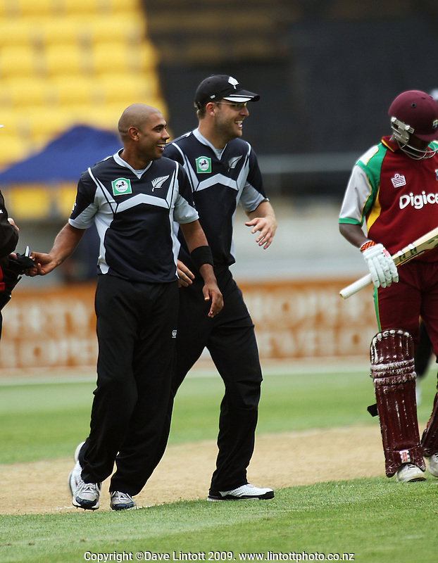 Jeetan Patel and Black Caps captain Daniel Vettori are all smile after Jamie How's catch has dismissed Fidel Edwards to wrap up the West Indies' inning at 128 during the 3rd One Day International  match between New Zealand and West Indies at Westpac Stadium, Wellington, New Zealand on Wednesday, 4 January 2009. Photo: Dave Lintott / lintottphoto.co.nz