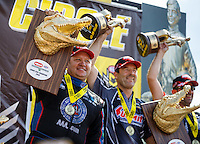 Mar 20, 2016; Gainesville, FL, USA; NHRA funny car driver Robert Hight (left) and pro stock driver Greg Anderson celebrates after winning the Gatornationals at Auto Plus Raceway at Gainesville. Mandatory Credit: Mark J. Rebilas-USA TODAY Sports