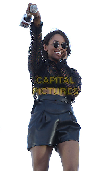 Kat Graham<br /> iHeart Radio Music Festival Village 2013 in Las Vegas, Las Vegas, Nevada, USA, 21st September 2013.<br /> music festival concert gig live on stage performing concert<br /> half length black top hand arm raised up sunglasses shorts leather fishnet cropped crop midriff <br /> CAP/ADM/MJT<br /> &copy; MJT/AdMedia/Capital Pictures