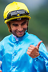 HONG KONG - MAY 04:  Joao Moreira of Portugal riding Tour De Four celebrates after winning the Admiralty at Sha Tin racecourse on May 4, 2014 in Hong Kong, Hong Kong.  Photo by Aitor Alcalde / Power Sport Images