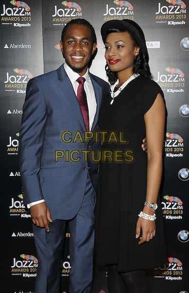 Nathaniel Facey & guest.attended the Jazz FM Awards 2013, One Marylebone, Marylebone Rd., London, England, 31st January 2013..half length blue suit red shirt tie black dress hat .CAP/CAN.©Can Nguyen/Capital Pictures.