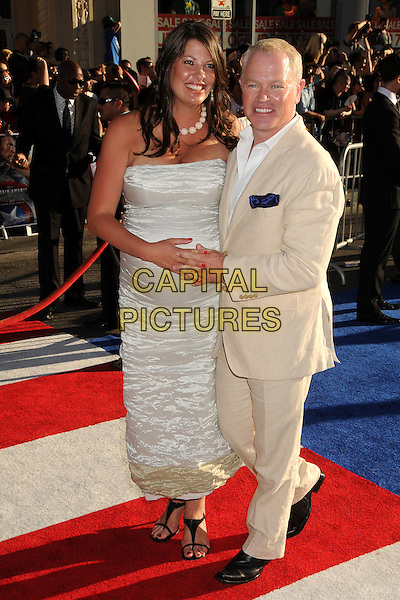 "Ruve Robertson & Neal McDonough.Premiere of ""Captain America: The First Avenger"" held at The El Capitan Theatre in Hollywood, California, USA..July 19th, 2011.full length dress white holding hands cream beige suit married husband wife.CAP/ADM/BP.©Byron Purvis/AdMedia/Capital Pictures."