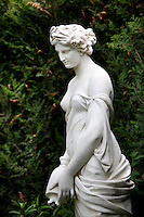 Mid-length view of the statue called Nymphe a la Cruche, created by Hippolyte-Isidore Brion in 1838 and located in the Iris Garden of the Jardin des Plantes, Paris, 5th arrondissement, France. Founded in 1626 by Guy de La Brosse, Louis XIII's physician, the Jardin des Plantes, originally known as the Jardin du Roi, opened to the public in 1640. It became the Museum National d'Histoire Naturelle in 1793 during the French Revolution.