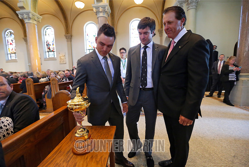 LATROBE, PA - OCTOBER 4: (L-R) Ricky Fowler, Bubba Watson and Phil Mickelson put the Ryder Cup on display during a Celebration of Arnold Palmer at Saint Vincent College on October 4, 2016 in Latrobe, Pa. (Photo by Hunter Martin/Getty Images) *** Local Caption *** Ricky Fowler;Bubba Watson;Phil Mickelson