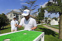 Mikko Ilonen (FIN) tries the chopsticks challenge during Tuesday's Pro-Am Day of the 2014 BMW Masters held at Lake Malaren, Shanghai, China 28th October 2014.<br /> Picture: Eoin Clarke www.golffile.ie