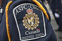 ASFC-CBSA badge is seen during a police memorial parade in Ottawa Sunday September 26, 2010.