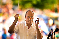 Ernest Pereira conducts the Charlotte Symphony Youth Orchestra as it performs during the Charlotte Symphony Summer Pops Series 2008, at SouthPark Mall.