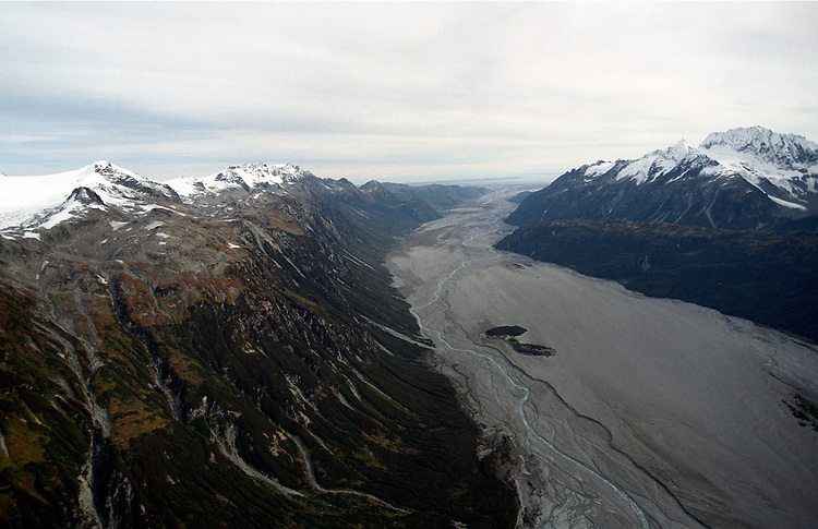 The Drift River valley drains away from Mount Redoubt volcano toward Cook Inlet in southcentral Alaska. When the volcano is erupting, flooding in the valley threatens an oil storage facility near the river's mouth on the shore of Cook Inlet.