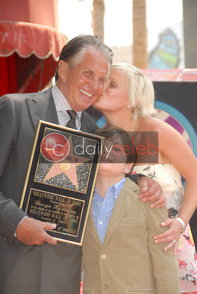 George Hamilton with Kimberly Blackford and their son George-Thomas<br />at the ceremony honoring George Hamilton with the 2,388th Star on the Hollywood Walk of Fame. Hollywood Boulevard, Hollywood, CA. 08-12-09<br />Dave Edwards/DailyCeleb.com 818-249-4998