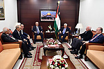 Palestinian President Mahmoud Abbas meets with his Prime Minister Rami Hamdallah following he returns from the Gaza Strip where an explosion targeted his convoy in the West Bank city of Ramallah on March 13, 2018. Hamdallah cut short a rare visit to Gaza on Tuesday after an explosion targeted his convoy, a source in the delegation said. The premier, who was not hurt, left Gaza Strip through the Erez crossing shortly after opening a wastewater treatment facility, the source said. Photo by Thaer Ganaim
