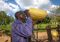 "Alphonse Elic, 51, stops twice a day at the Ageci village borehole on his six kilometer trek to school, almost 2 hrs each way, where he is an English teacher at the primary school. ""You have helped me, he says. Every day I stop here to drink and I am so happy to have water on my journey to and from school…"" This well serves about 500 people."