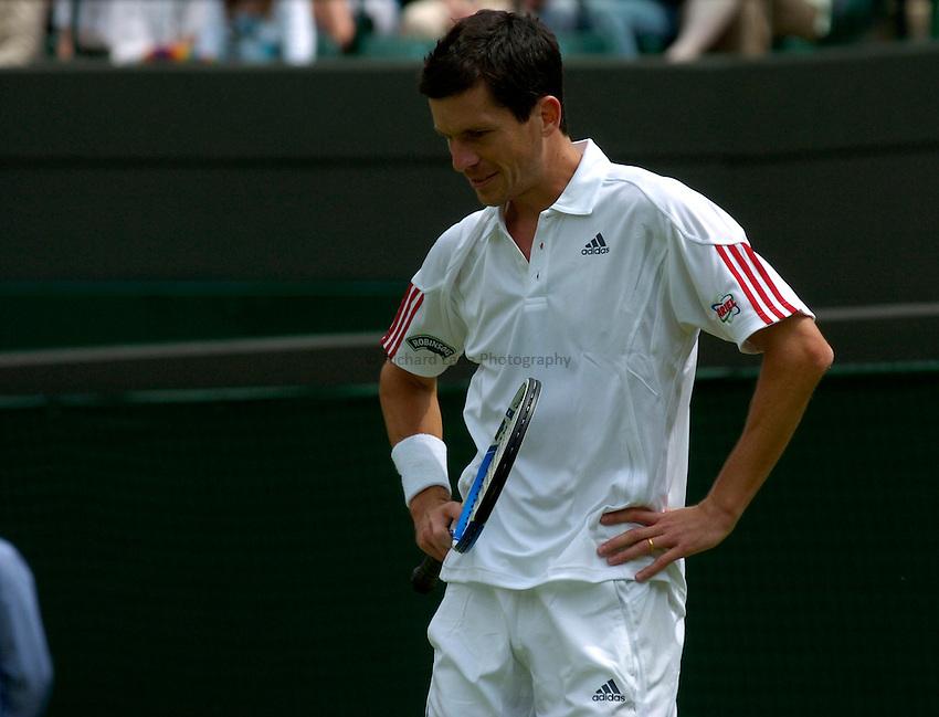 Photo: Richard Lane..Wimbledon Championships. 27/06/2006. .Great Britain's Tim Henman shows his dejection.