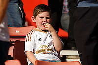 A young Swansea City fan during the Barclays Premier League match between Southampton v Swansea City played at St Mary's Stadium, Southampton