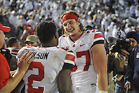 25 October 2014:  Ohio State DE Joey Bosa (97) smiles and celebrates after the 2 OT win. The Ohio State Buckeyes defeated the Penn State Nittany Lions 31-24 in 2 OTs at Beaver Stadium in State College, PA.