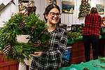 BETHLEHEM, CT. 06 December 2018-120618 - Shannon Carrizzo of Bethel shows off her finished wreath to her mother-in-law during the annual Wreath making social event at March Farms in Bethlehem on Thursday. Sue March the owner of March Farms says for everyone to sig up and get your spots early next year as they went very quickly this year. Bill Shettle Republican-American