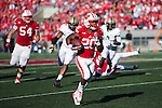 Wisconsin Badgers running back James White (20) carries the ball during an NCAA Big Ten Conference football game against the Purdue Boilermakers on Saturday, September 21, 2013, in Madison, Wis. The Badgers won 41-10. (Photo by David Stluka)