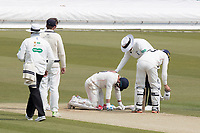 The Umpires check Rob Jones of Lancashire CCC after he was felled by a short delivery from James Harris during Middlesex CCC vs Lancashire CCC, Specsavers County Championship Division 2 Cricket at Lord's Cricket Ground on 13th April 2019
