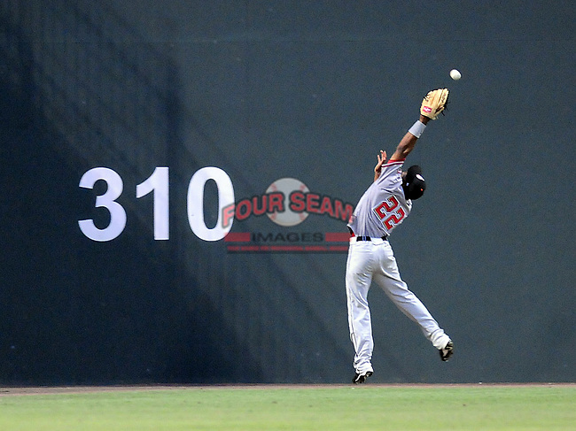 Destin Hood reaches for a fly ball over his head at the 2010 South Atlantic League All-Star Game on Tuesday, June 22, 2010, at Fluor Field at the West End in Greenville, S.C. Photo by: Tom Priddy/Four Seam Images