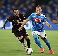 12th July 2020; Stadio San Paolo, Naples, Campania, Italy; Serie A Football, Napoli versus AC Milan;  Stanislav Lobotka of Napoli holds off Hakan Calhanoglu of AC Milan