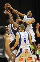 Benny Anthony Jr and Corey Webster compete for a rebound during the national basketball league final between Wellington Saints and Bay Hawks at TSB Bank Arena, Wellington, New Zealand on Saturday, 5 July 2014. Photo: Dave Lintott / lintottphoto.co.nz