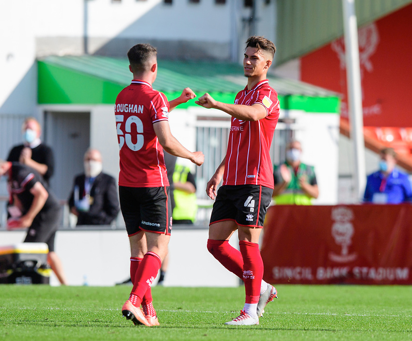 Lincoln City's Sean Roughan, left, bumps fits with team-mate Lewis Montsma as he leaves the field to be substituted<br /> <br /> Photographer Chris Vaughan/CameraSport<br /> <br /> The EFL Sky Bet League One - Saturday 12th September 2020 - Lincoln City v Oxford United - LNER Stadium - Lincoln<br /> <br /> World Copyright © 2020 CameraSport. All rights reserved. 43 Linden Ave. Countesthorpe. Leicester. England. LE8 5PG - Tel: +44 (0) 116 277 4147 - admin@camerasport.com - www.camerasport.com - Lincoln City v Oxford United
