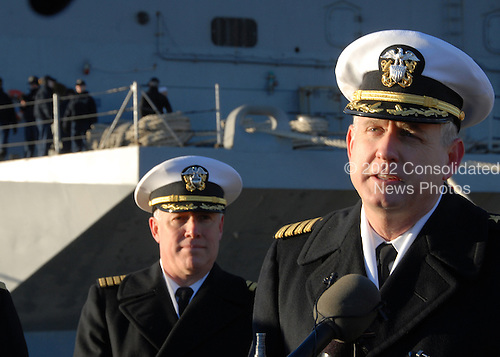 Captain Dee L. Mewbourne, commanding officer of the aircraft carrier USS Enterprise (CVN 65), responds to questions by the media while Sailors prepare to get the ship underway, Thursday, January 13, 2011. Enterprise is deploying as part of the Commander, Carrier Strike Group (CCSG) 12 in support of maritime security operations and theater security cooperation efforts in the U.S. 5th and 6th Fleet areas of responsibility. .Mandatory Credit: Eric Garst - U.S. Navy via CNP