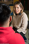 Education High School female teacher having discussion with male student, mentoring relationshiop