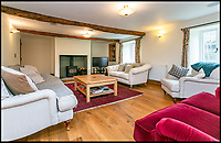 BNPS.co.uk (01202)558833<br /> Pic:    Savills/BNPS<br /> <br /> Sitting room inside the main house.<br /> <br /> A country estate that has its own farm, tea rooms and glamping business in the heart of the Lake District has gone on market for those looking to escape the rat race.<br /> <br /> Backside Farm sits on the banks of Ullswater - the second largest lake in the Cumbrian National Park - and has one mile of water access as well as stunning views of the mountains. <br /> <br /> The outgoing owners have been on the 195 acre estate for over a decade and in that time they have renovated the large five bedroom farmhouse.<br /> <br /> They also set up the tea rooms and two holiday rental cabins and have established them as a business.