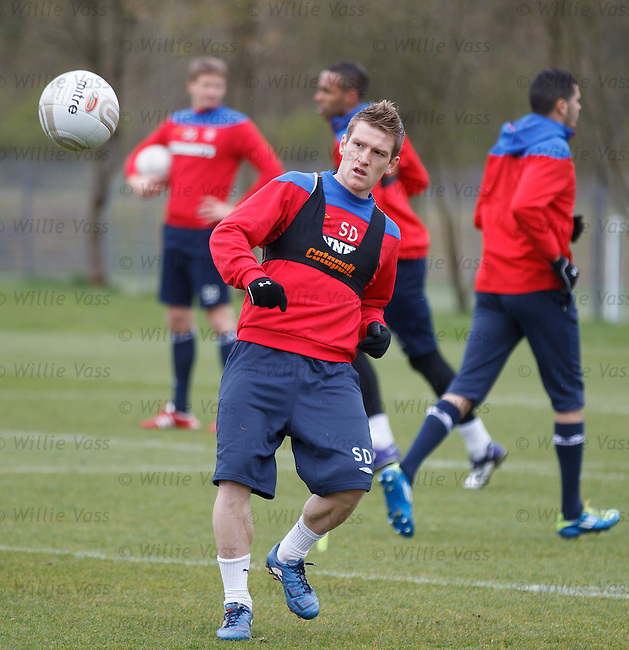 Steven Davis cushions the ball as he volleys it back