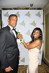 """Master of Ceremony Sharif Atkins (White  Coller """"Agent Jones"""", ER """"Michael Gallant"""", The Good Wife and more) gets a boutineer from Delaina Dixon - President - Alpha Kappa Alpha Sorority, Incorporated Pi Psi Omega Chapter welcomes you to """"A Pink Carpet Affair"""" - celebrating 25 years of Sisterhood and Service on June 9, 2012 at the Comfort Inn and Suites, Nanuet, New York.  (Photo by Sue Coflin/Max Photos)"""