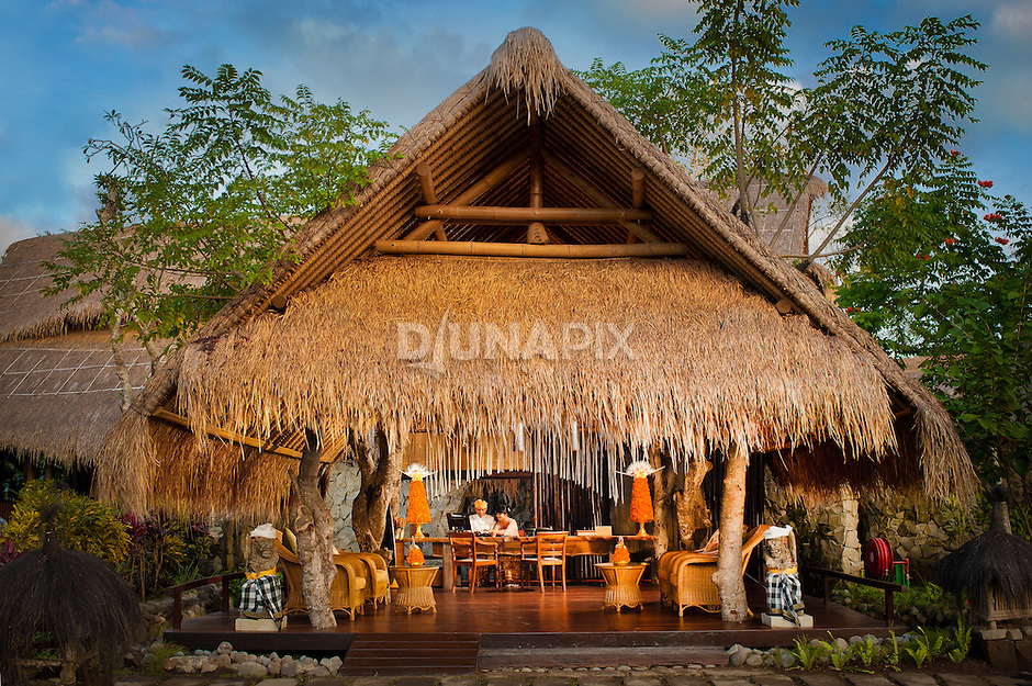 Fivelements reception, inspired by a Balinese rice paddy hut, constructed around six living trees.