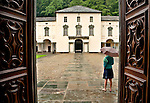 "The Sanctuary of the ""Black Madonna of Oropa"" located 13 km from Biella's city center, is a famous pilgrimage with a large square (1600-1800) in the center, as seen from the doors of the ancient basilica on a rain day"