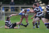 30th November 2013; Daren Claasen, Corinthians, is tackled by Shane Donovan and John Bollard, Terenure. Ulster Bank League Division 1B, Corinthians v Terenure, Corinthian Park, Galway. Picture credit: Tommy Grealy/actionshots.ie.
