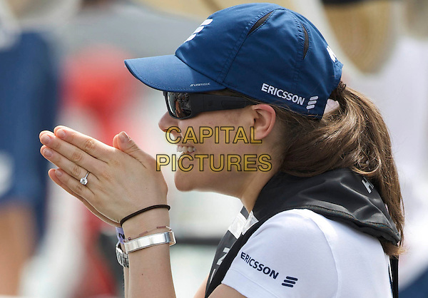 CROWN PRINCESS VICTORIA OF SWEDEN.On board the sail boat Ericsson 4 during the Volvo Ocean Race 2008 - 2009, Marina Gloria, Rio de Janeiro, Brazil, April 3rd 2009..swedish royal family half length blue cap hat white t-shirt side profile engagement ring hands sunglasses .CAP/PPG/JH.©Jens Hartmann/People Picture/Capital Pictures