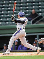 Infielder Kyle Ruchim (9) of the Northwestern Wildcats hits in a game against the Furman University Paladins on Saturday, February 16, 2013, at Fluor Field in Greenville, South Carolina. The game was cancelled in the fifth inning due to snow. (Tom Priddy/Four Seam Images)