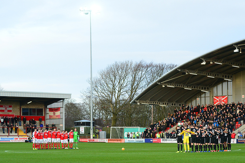 The Fleetwood Town and Portsmouth players acknowledge a minutes silence for former Fleetwood player Jim Strachan<br /> <br /> Photographer Richard Martin-Roberts/CameraSport<br /> <br /> The EFL Sky Bet League One - Fleetwood Town v Portsmouth - Saturday 29th December 2018 - Highbury Stadium - Fleetwood<br /> <br /> World Copyright © 2018 CameraSport. All rights reserved. 43 Linden Ave. Countesthorpe. Leicester. England. LE8 5PG - Tel: +44 (0) 116 277 4147 - admin@camerasport.com - www.camerasport.com