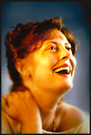 Susan Sarandon in southern CA. In her apartment during a publicity shoot by the Los Angeles Times photographer Jim Mendenhall circe 1992 more or less. copyright Los Angeles Times. 2013 scan from a dye tranfer print. Original shot on Kodak 25 ISO negative film with combination of artificial light, tungsten model light in a small strip light box on a Dynalight head and daylight.