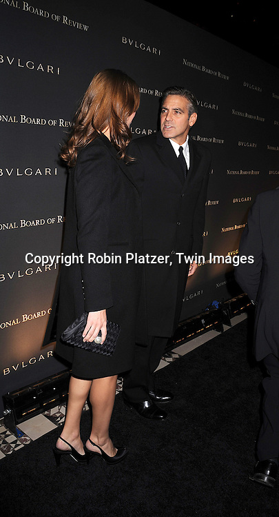 Sarah Lawson and George Clooney.posing for photographers at The 2007 National Board of Review of Motion Pictures Awards Gala presented by Bulgari on January 15, 2008 at Cipriani's 42nd Street. .Robin Platzer, Twin Images