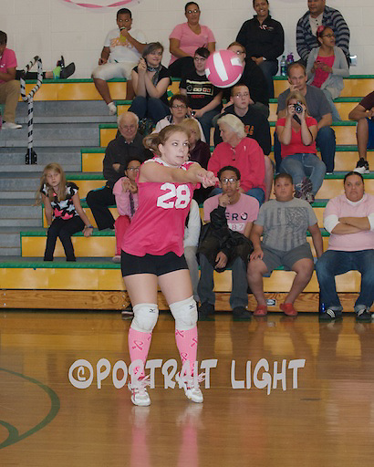 Clinton High senior captain Kelsey Rouleau receives the ball on Pink Night.