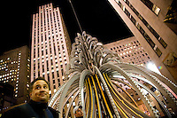 "NEW YORK - FEB 19 : Workmen install an electric fountain sculpture designed by British artists Tim Noble and Sue Webster in Rockefeller Plaza on Tuesday, February 19, 2008, in New York City. (Photo by Landon Nordeman)..From Feb. 27 through Apr. 5, the Plaza at Rockefeller Center will be bathed in the LED-generated light of Electric Fountain, one of the few major public art installations by the acclaimed British artists Tim Noble and Sue Webster. This monumental 3-D outdoor light sculpture will be 35 feet (10.72 meters) high and 30 feet (10.6 meters) in diameter. Fabricated from 3,390 LED bulbs and 527 meters of neon tubing, the design and sequencing will replicate the movement of water: streaming, pooling, splashing and flowing, creating a hypnotic experience for viewers. Presented by Art Production Fund, sponsored by Lexus, and hosted by Tishman Speyer, co-owners of Rockefeller Center, Electric Fountain will be on view, free and open to the public...""The project mimics the tradition of a fountain as a monument found in public squares around the world, but its magic lies in the emulation of light where water should be,"" said artist Sue Webster. ""During daylight hours the viewer will really get a sense of Electric Fountain's architectural and sculptural qualities as the lights react with the changing moods of New York City's daily weather conditions. As nighttime falls, the sculptural form will slowly disappear into darkness leaving only the illusion of bright cascading water in its wake.""."