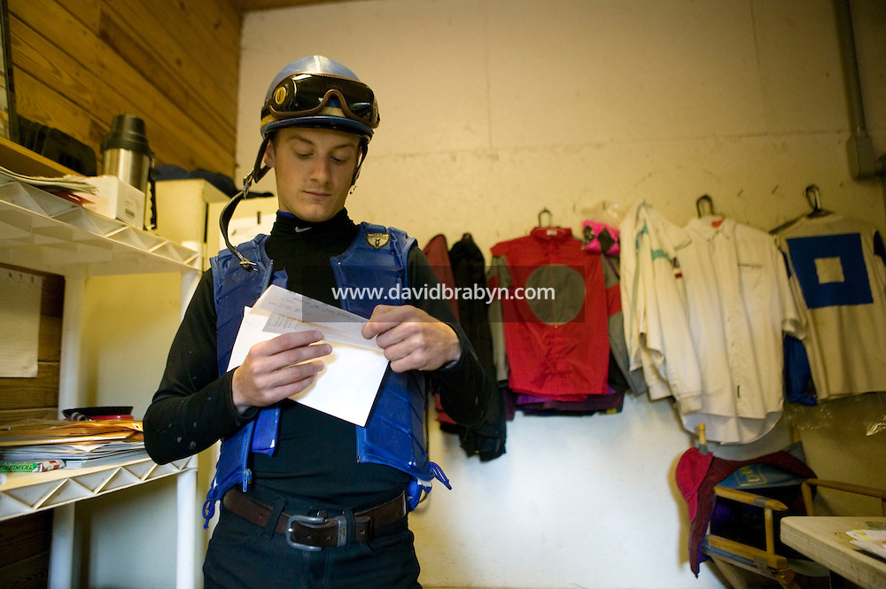 Jockey Julien Leparoux receives a check from a race in Chicago at the Biancone stable in Saratoga Springs, NY, United States, after completing the morning practice rides, 5 August 2006. By August 8th his 2006 earning totalled $7,041,736.