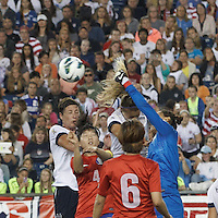 Corner kick. USWNT substitute forward Abby Wambach (20) and USWNT defender Kristie Mewis (8), Korea Republic goalkeeper Kim Jungmi (1). In an international friendly, the U.S. Women's National Team (USWNT) (white/blue) defeated Korea Republic (South Korea) (red/blue), 4-1, at Gillette Stadium on June 15, 2013.