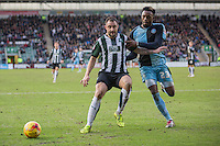 Peter Hartley of Plymouth Argyle shepherds the ball away from Gozie Ugwu of Wycombe Wanderers during the Sky Bet League 2 match between Plymouth Argyle and Wycombe Wanderers at Home Park, Plymouth, England on 30 January 2016. Photo by Mark  Hawkins / PRiME Media Images.